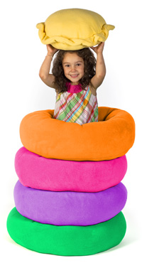 Girl with stack of Cozy Puff dog beds